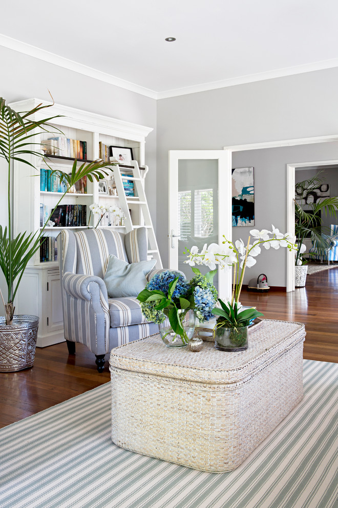 Living room - coastal formal and enclosed dark wood floor living room idea in Perth with gray walls