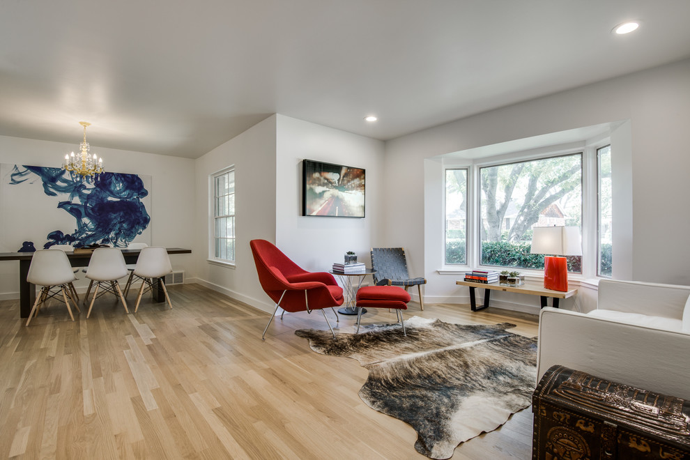 Example of a mid-sized danish formal and open concept light wood floor living room design in Dallas with white walls, no fireplace and no tv