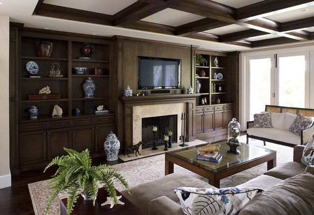 dark stained cabinets and beams, limestone fireplace and hearth