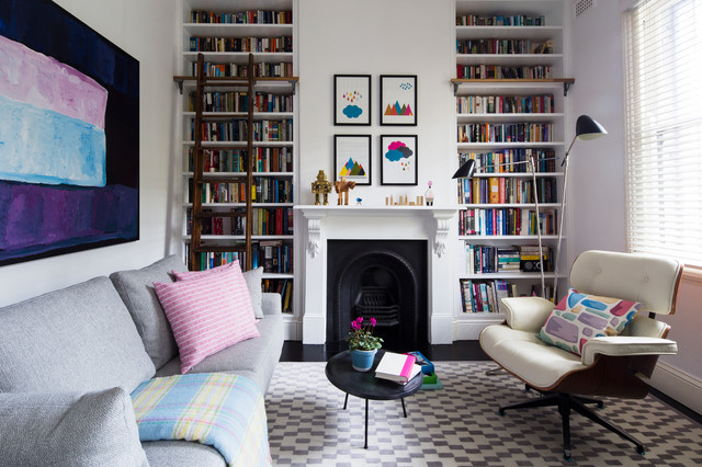 Living room library - eclectic living room library idea in Sydney with white walls and a standard fireplace