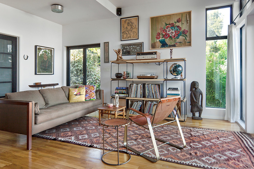Mid-sized danish open concept medium tone wood floor living room photo in Los Angeles with a music area