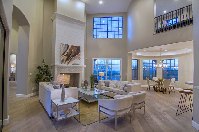 Living room - large transitional formal and open concept medium tone wood floor and brown floor living room idea in Phoenix with brown walls, a standard fireplace, a tile fireplace and no tv