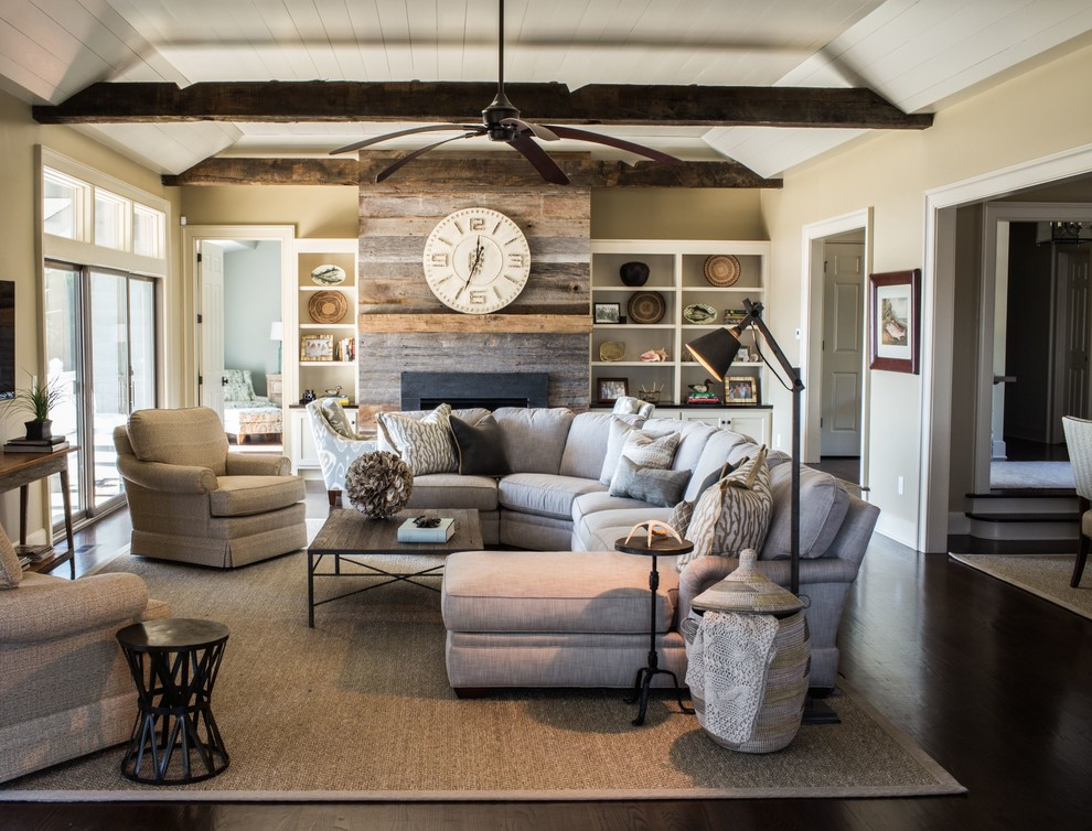 Living room - transitional formal and enclosed dark wood floor living room idea in Charleston with beige walls and a standard fireplace