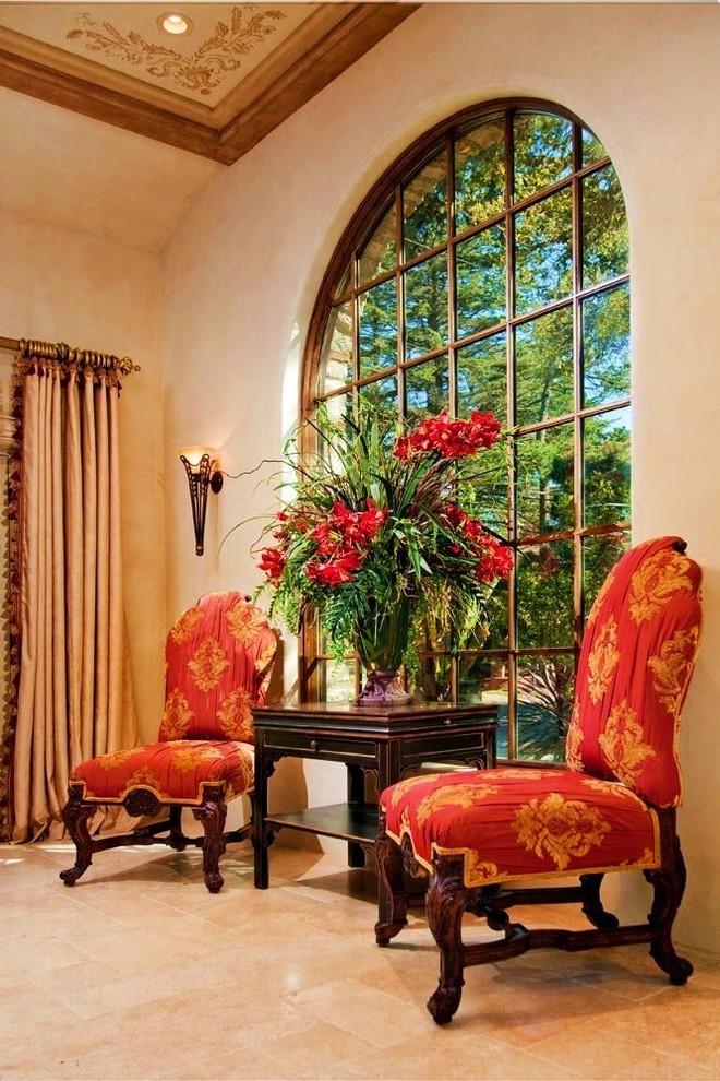 Example of a tuscan limestone floor living room design in Seattle