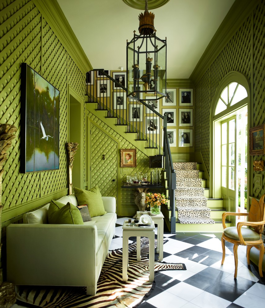 Example of a large classic formal living room design in New York with green walls, no tv and no fireplace
