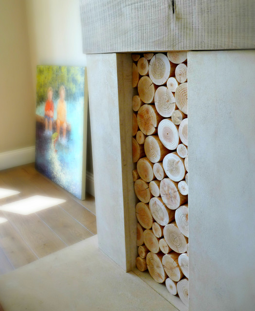 Decorative Logs Stacked in an Alcove of a Large Open Fireplace