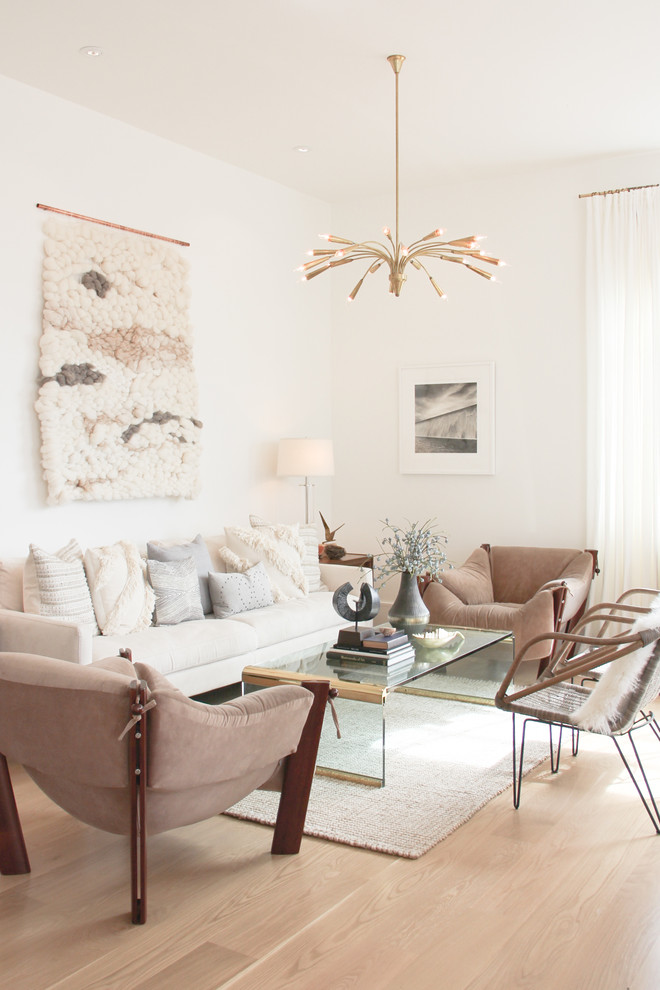 Inspiration for a scandinavian light wood floor living room remodel in San Francisco with white walls
