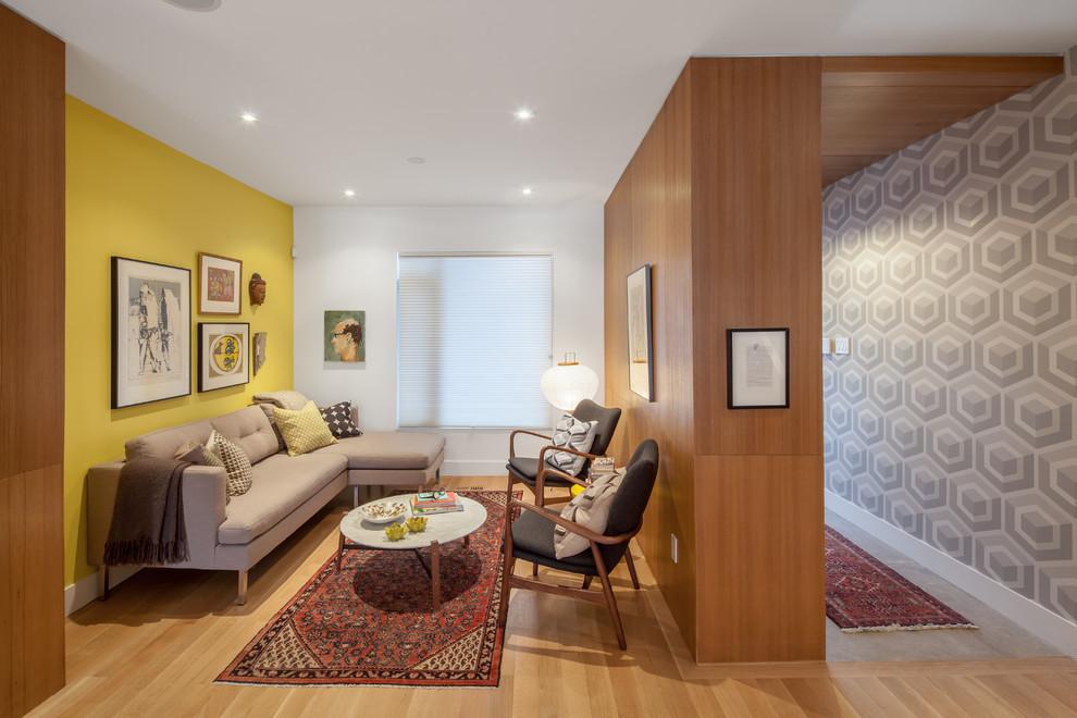 Trendy formal light wood floor living room photo in Toronto with yellow walls