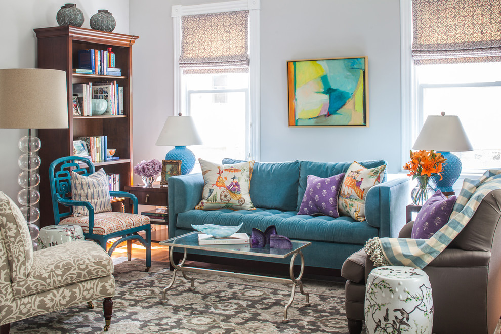 Living room - mid-sized traditional enclosed medium tone wood floor living room idea in DC Metro with gray walls