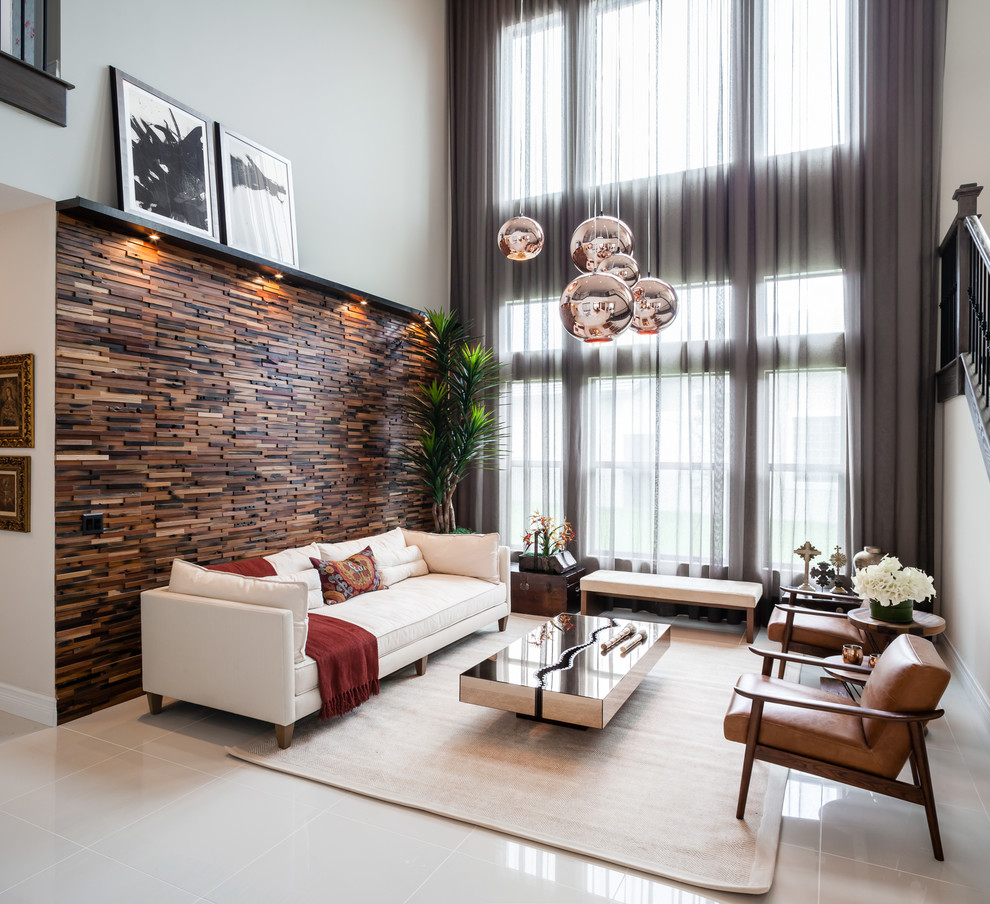 Example of a mid-sized trendy formal and open concept living room design in Miami with brown walls, no fireplace and no tv