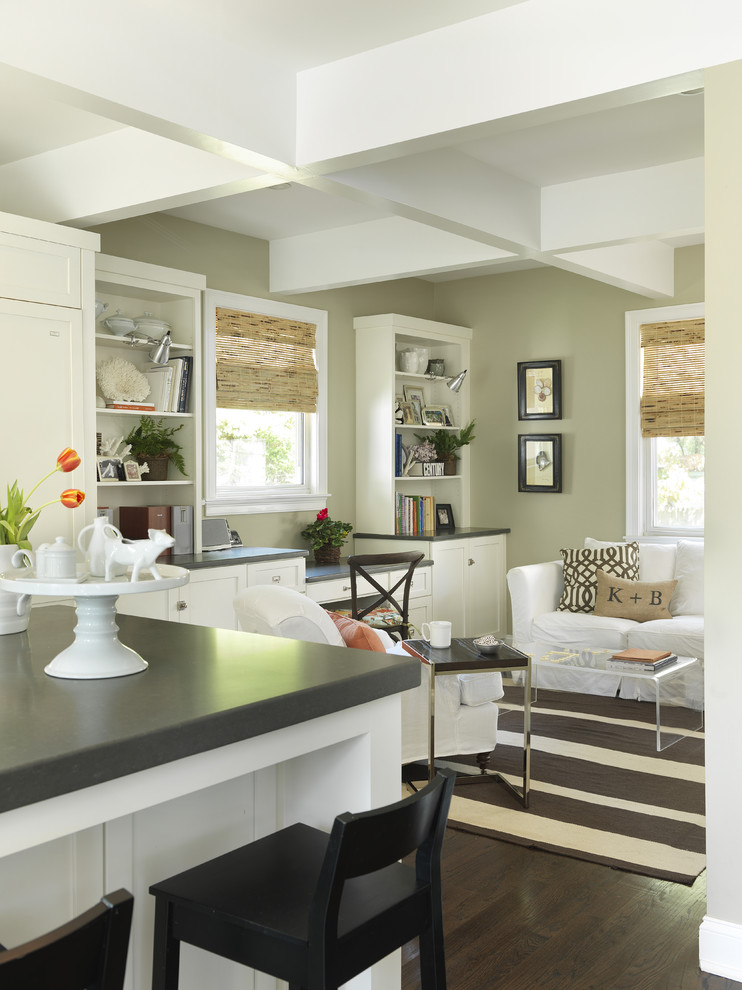 Example of a transitional dark wood floor living room design in Providence with beige walls