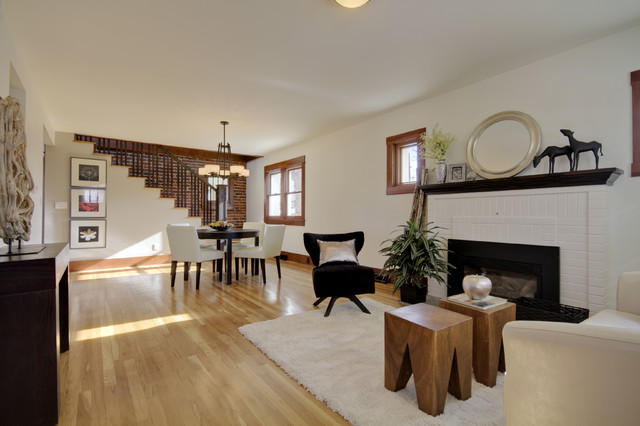 Living room - mid-sized eclectic open concept light wood floor and brown floor living room idea in Denver with beige walls, a standard fireplace and a brick fireplace