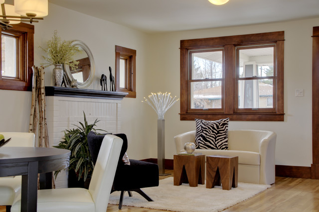 Example of a mid-sized eclectic open concept light wood floor and brown floor living room design in Denver with beige walls, a standard fireplace and a brick fireplace