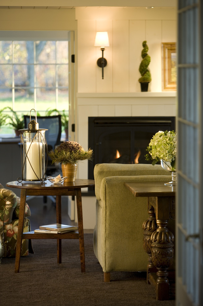 Inspiration for a farmhouse living room remodel in Burlington with a wood fireplace surround and a standard fireplace