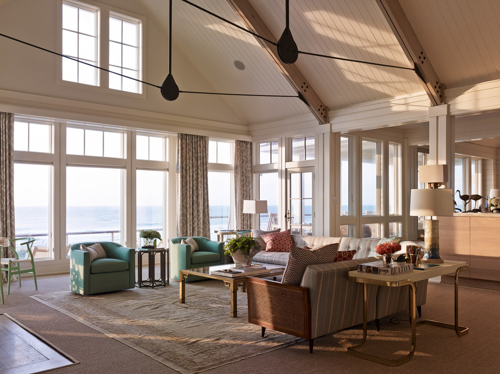 Inspiration for a coastal open concept carpeted and brown floor living room remodel in Seattle with white walls