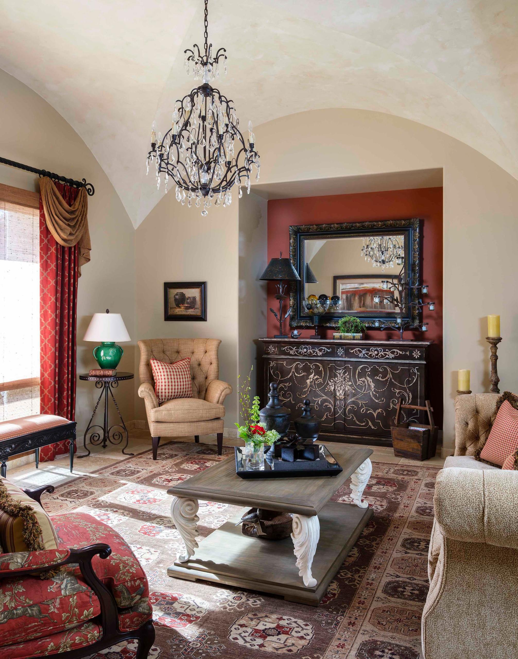 Example of a tuscan travertine floor living room design in Phoenix with beige walls