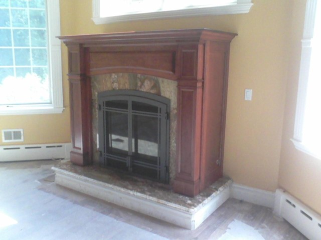 This is a Regency Bellavista direct vent gas fireplace in a Collinswood mantel cabinet.