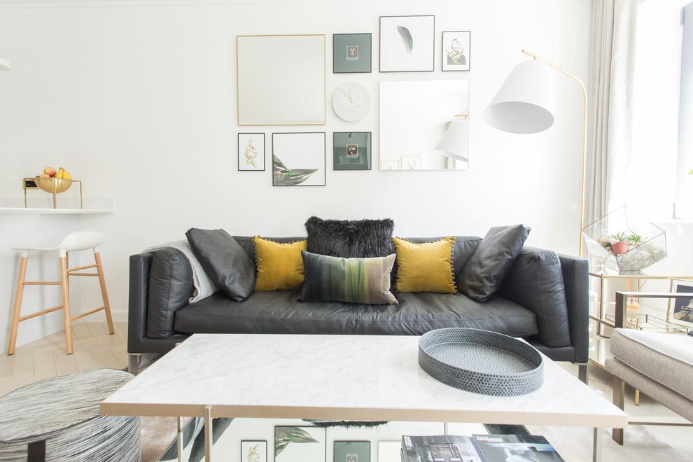 Danish light wood floor and beige floor living room photo in Other with white walls