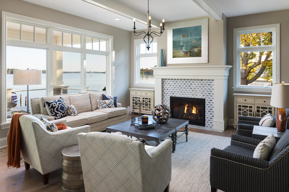 Beach style formal living room photo in Grand Rapids with gray walls, a standard fireplace and a tile fireplace