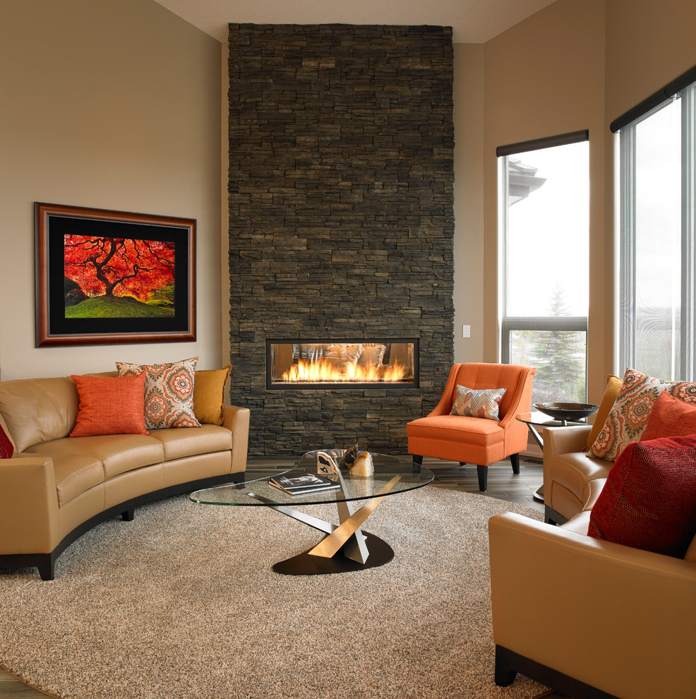 Inspiration for a large contemporary open concept porcelain tile living room remodel in Calgary with beige walls, a two-sided fireplace and a stone fireplace