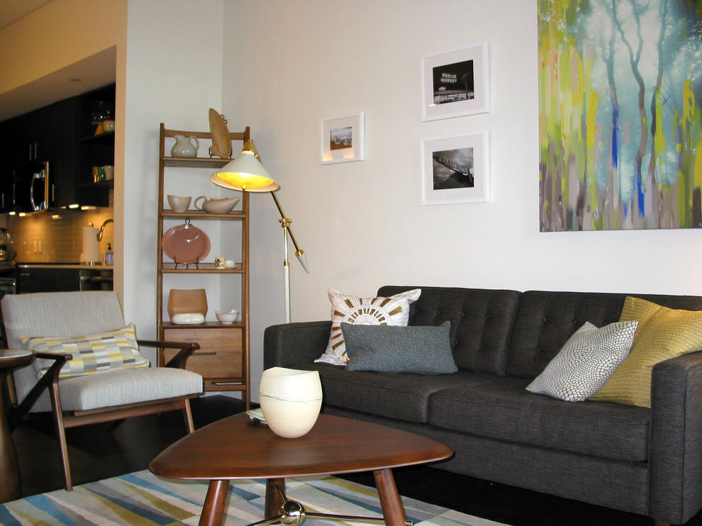 Small mid-century modern open concept dark wood floor living room photo in Seattle with white walls and a tv stand