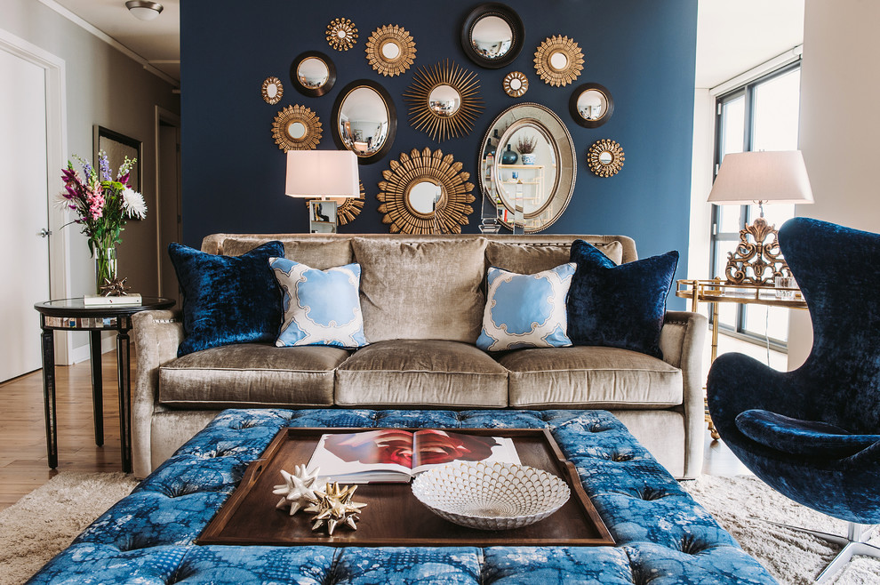 Transitional medium tone wood floor living room photo in Chicago with blue walls