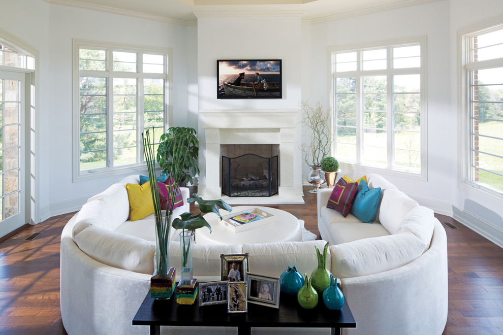 Inspiration for a contemporary living room remodel in Indianapolis with white walls, a standard fireplace and a wall-mounted tv