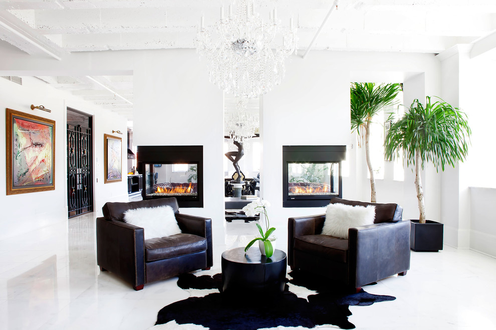 Example of a trendy marble floor and white floor living room design in Montreal with a two-sided fireplace