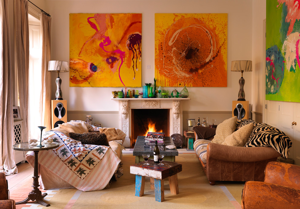 Eclectic formal living room photo in London with beige walls and a standard fireplace