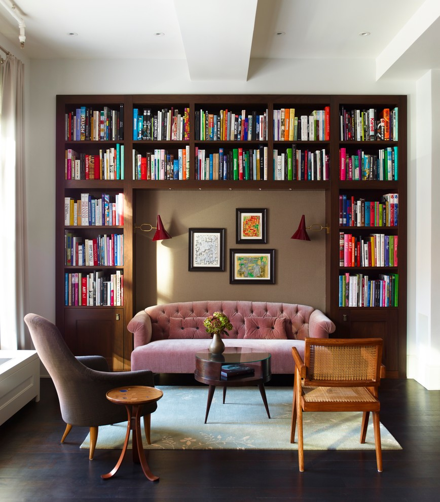 Inspiration for a transitional open concept dark wood floor living room library remodel in New York with white walls