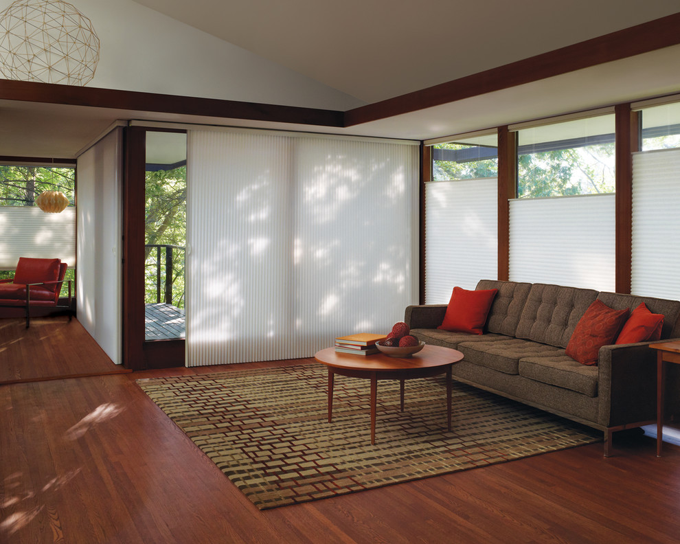 Inspiration for a contemporary open concept medium tone wood floor living room remodel in San Francisco with no fireplace, no tv and beige walls
