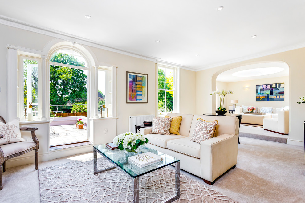 Transitional carpeted living room photo in London with beige walls