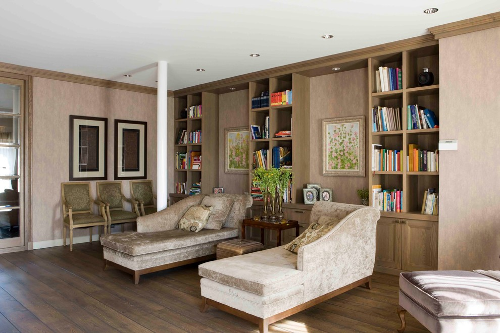 Inspiration for a large timeless enclosed medium tone wood floor living room library remodel in New York with beige walls and no tv