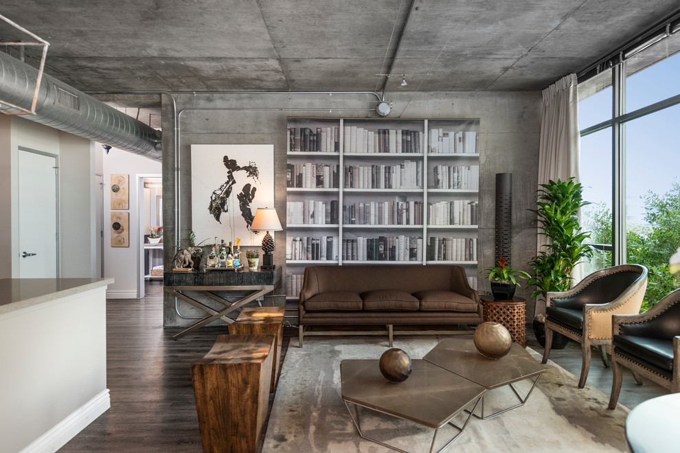 Living room - mid-sized industrial formal medium tone wood floor living room idea in Los Angeles with gray walls, no fireplace and no tv