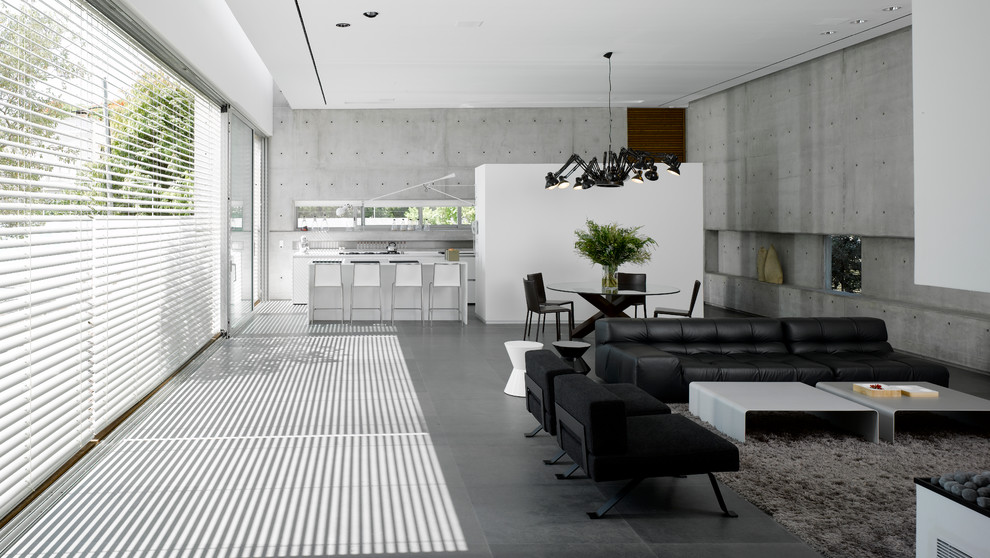 Example of a large urban open concept concrete floor and gray floor living room design in Other with gray walls, no fireplace and no tv