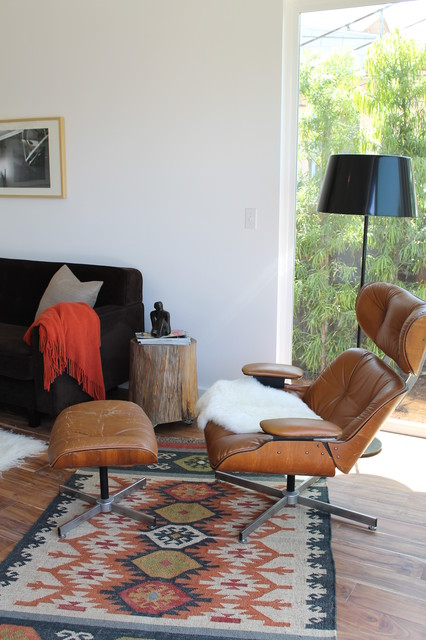 Eames-Era Plycraft Lounge Chair and Kilim Rug modern living room