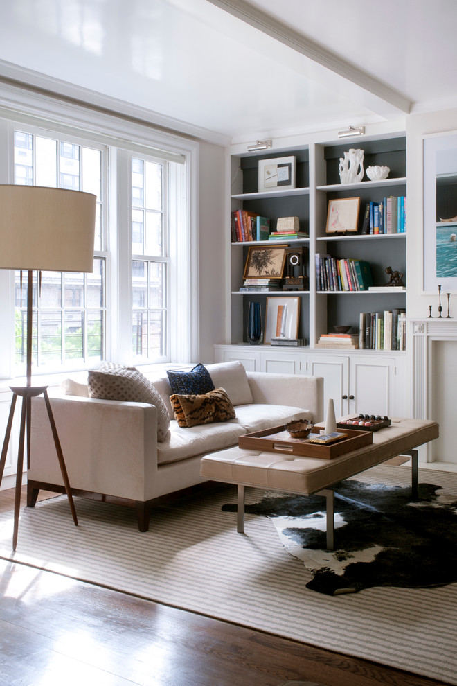 Inspiration for a transitional living room remodel in New York with a standard fireplace