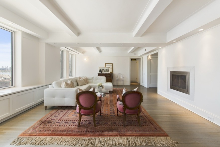 Example of a mid-sized trendy formal and open concept light wood floor and beige floor living room design in New York with white walls, a ribbon fireplace, a metal fireplace and no tv
