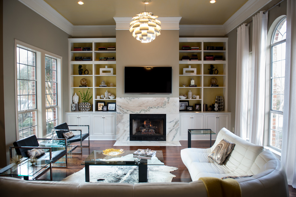 Living room - large contemporary open concept dark wood floor living room idea in New Orleans with gray walls, a wall-mounted tv, a standard fireplace and a stone fireplace