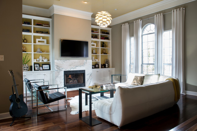 Example of a large trendy open concept dark wood floor living room design in New Orleans with gray walls, a standard fireplace, a stone fireplace and a wall-mounted tv