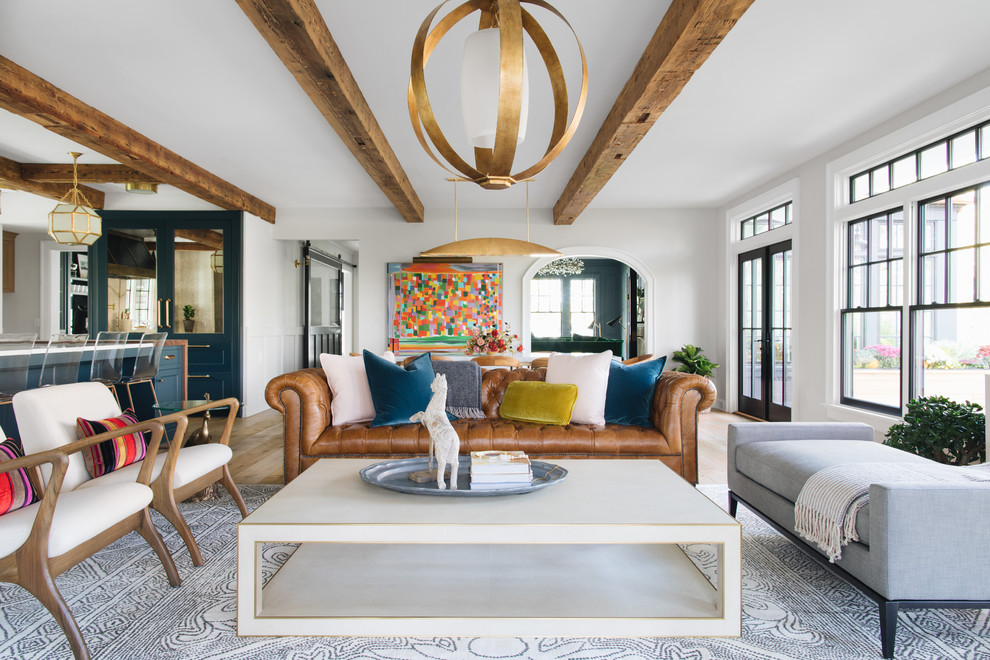 Living room - mid-sized transitional enclosed living room idea in Grand Rapids with white walls