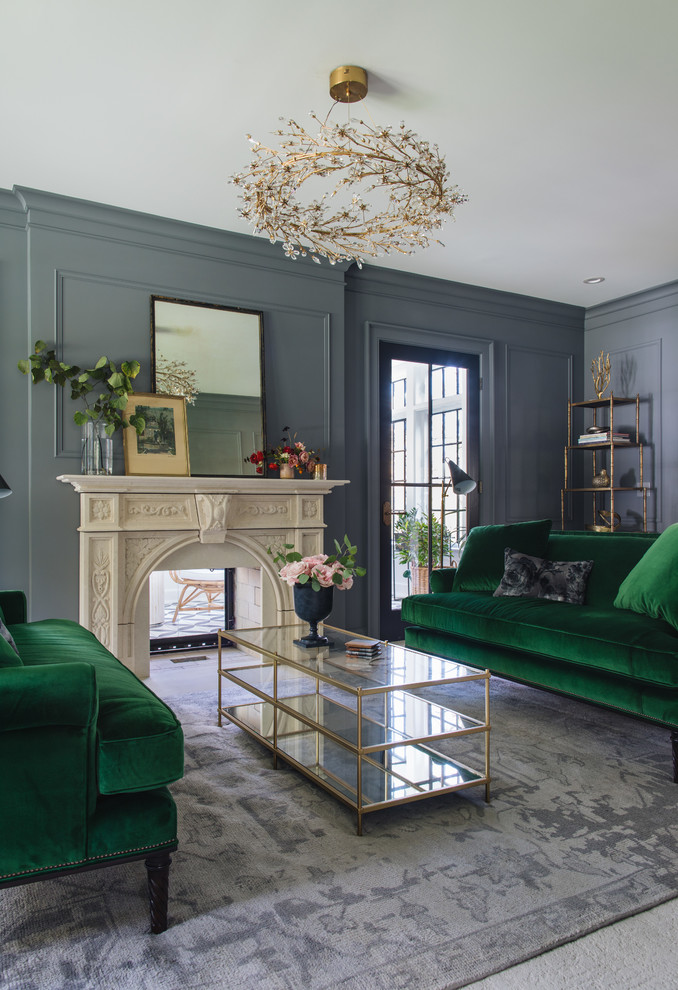 Example of a mid-sized transitional enclosed and formal carpeted and gray floor living room design in Grand Rapids with blue walls, a standard fireplace and a plaster fireplace