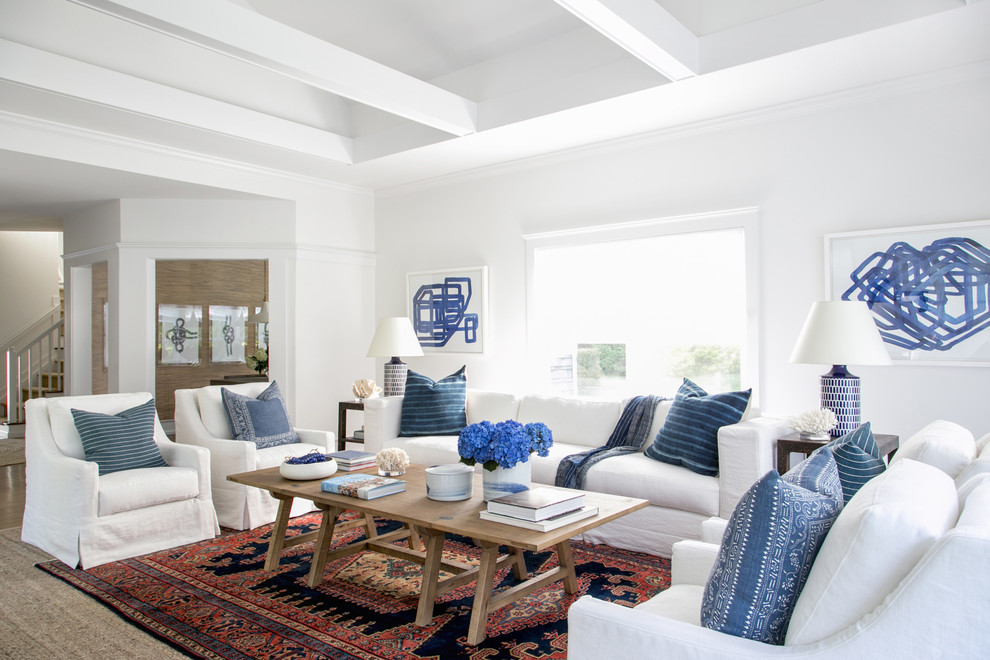 Example of a large transitional formal and open concept medium tone wood floor living room design in New York with white walls and no tv