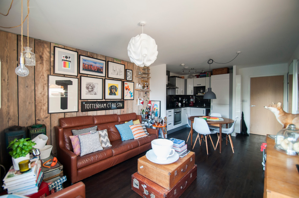Living room - mid-sized eclectic formal and open concept living room idea in London with white walls and a tv stand