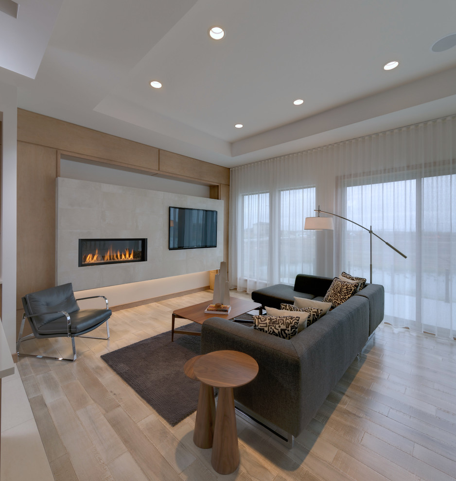 Living room - mid-sized contemporary open concept light wood floor and beige floor living room idea in Other with beige walls, a ribbon fireplace, a wall-mounted tv and a concrete fireplace