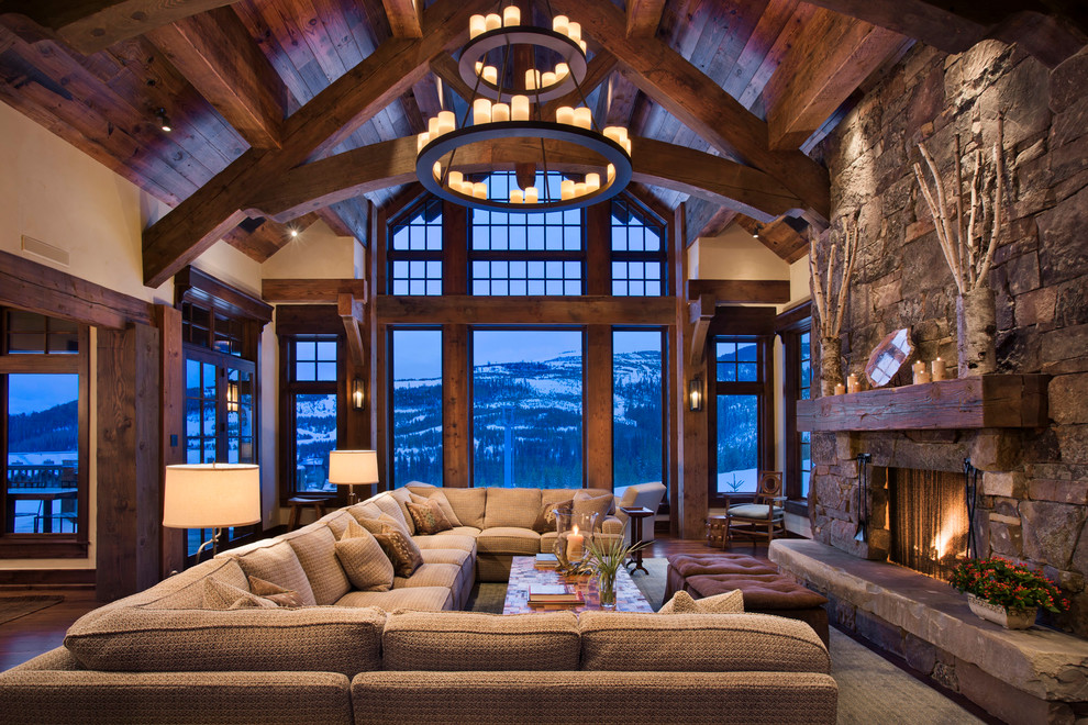 Example of a mountain style living room design in Other with a standard fireplace and a stone fireplace