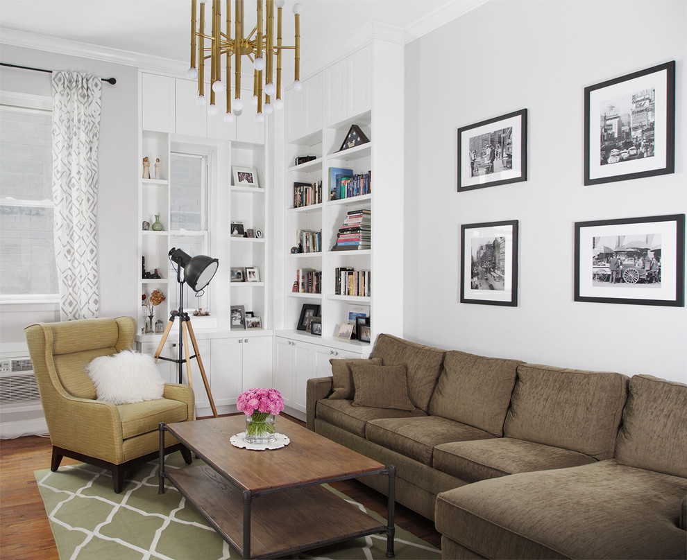 Example of a small transitional enclosed medium tone wood floor living room library design in New York with white walls, a standard fireplace, a tile fireplace and a tv stand