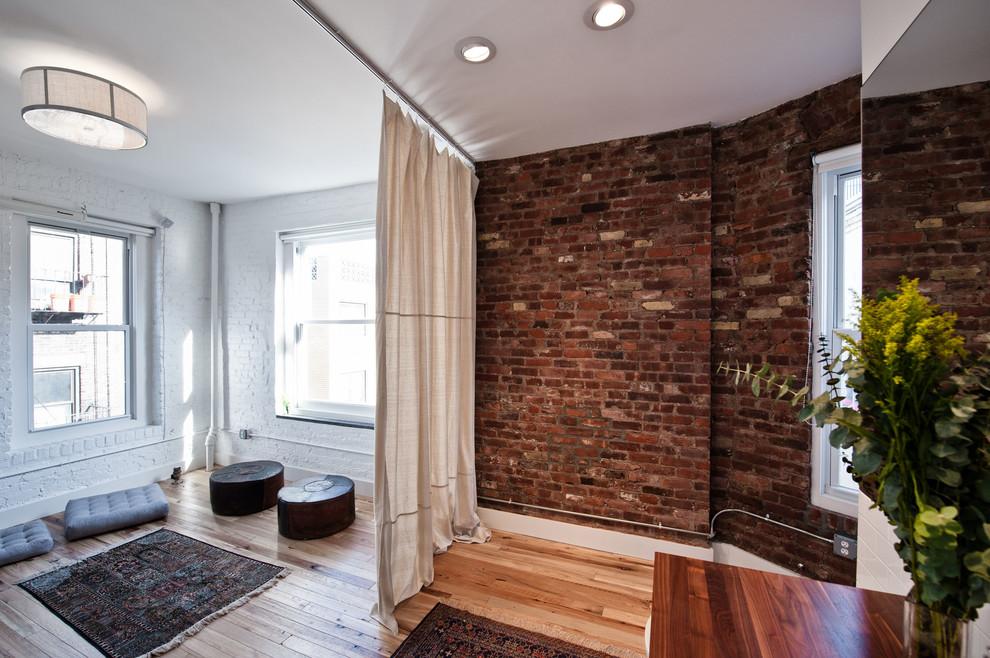 Example of a trendy medium tone wood floor living room design in New York