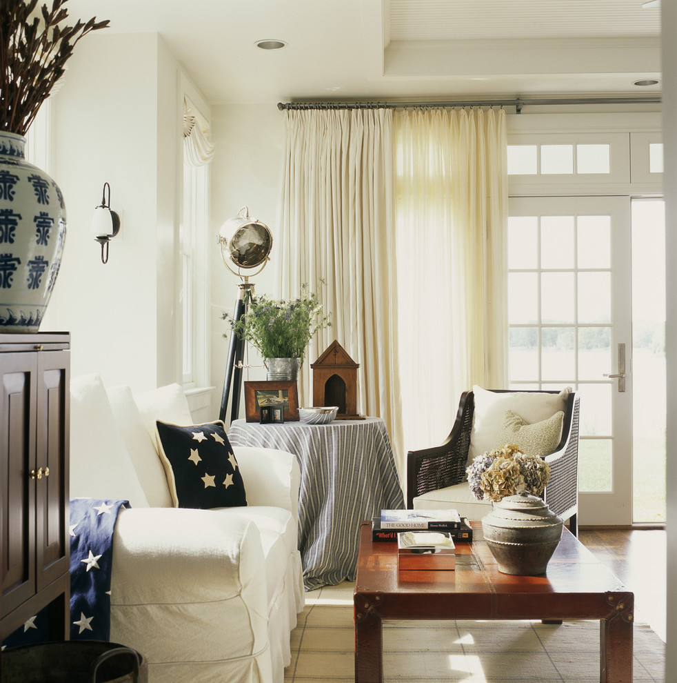 Mountain style living room photo in DC Metro with white walls