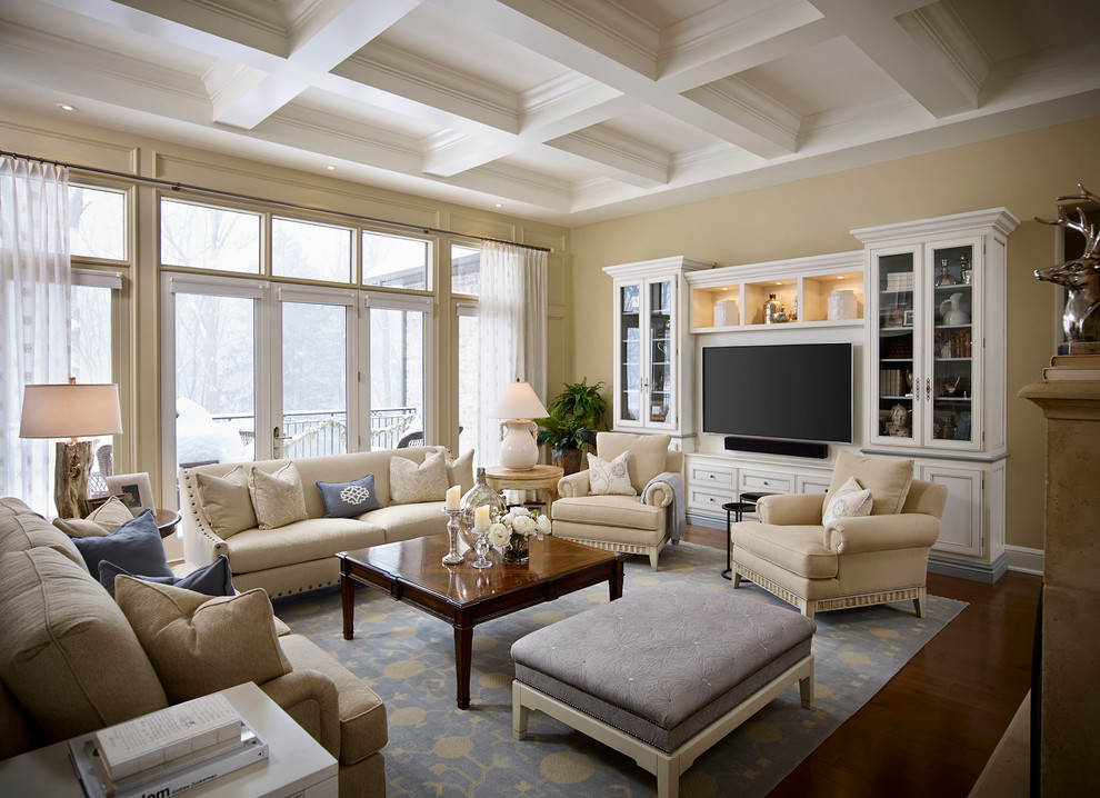 Inspiration for a large timeless open concept dark wood floor living room remodel in Toronto with beige walls and a media wall